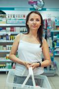 Young woman shopping in the store household chemicals and cosmetics Stock Photos