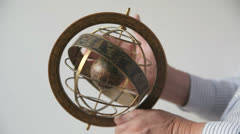 Man spins armillary sphere Stock Footage