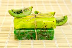 Stock Photo of soap homemade with twine and kiwi