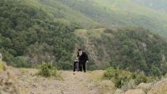 Business Travel Man Suit Bag Walking Rocks Success Concept Background HD - stock footage