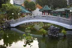 Chinese good fortune water garden bridge reflection wong tai sin taoist templ Stock Photos
