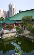 Red pavilion good fortune water garden wong tai sin taoist temple kowloon hon Stock Photos