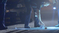 Police collecting evidence 01 Stock Footage