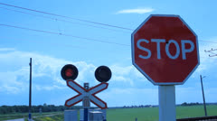 Railroad crossing with traffic lights and stop sign Stock Footage