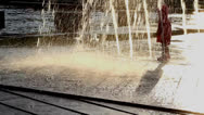 Stock Video Footage of Baby girl in red raincoat and water fountains