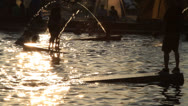 Stock Video Footage of Hot summer scenery : people and water fountains at sunset