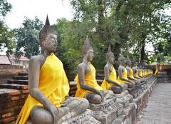 Ancient buddha statues at wat yai chai mongkol, ayutthaya, thailand Stock Photos