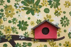 Red wooden bird house Stock Photos