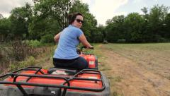 Following female on four wheeler - stock footage