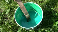 Green paint in the bucket Stock Footage