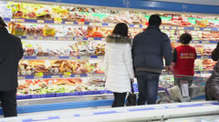 Consumers shopping in supermarket - stock footage