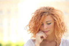 Young Adult Woman in Pensive Mood Stock Footage