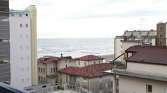Small resort in Italy. Roofs of houses and sea. Stock Footage