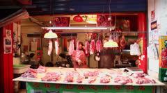Meat laid out on counter of butcher's stall. Stock Footage