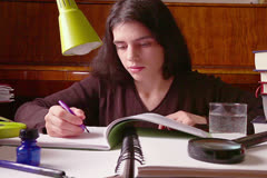 Young Woman Writes Homework - stock footage