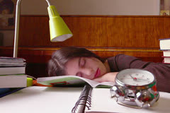 Woman Student Sleeps on Books Behind Clock Stock Footage