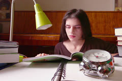 Woman Student Falls Asleep on Books Behind Clock Stock Footage