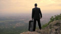Business Businessman Loooking at City Skyline Travel Bag Opportunity Concept HD Stock Footage