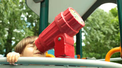 Little Baby Girl Looks Through Kaleidoscope Stock Footage