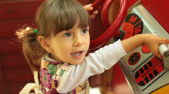 Little Baby Girl Plays Toy Ship Stock Footage