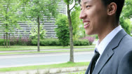 Stock Video Footage of Five international businesspeople meeting in front of a company builduíng