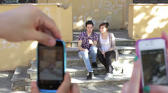 Two guys goofing around doing funny poses - cell phones - photo - make faces Stock Footage