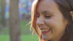 close up of beautiful smiling laughing young woman - stock footage