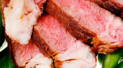 meaty food : roasted red meat steak - stock footage