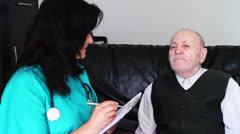 Nurse listening senior man Stock Footage