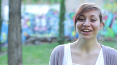 Timid woman laughing and looking at the camera Stock Footage