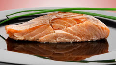 Healthy fish cuisine : baked pink salmon on black Stock Footage