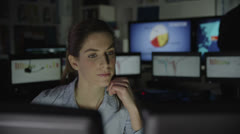 Tired businesswoman working late at her desk - stock footage