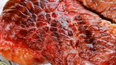 Meat food : grilled beef steak on white plate with red chili pep Stock Footage