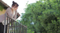 man climbs up to the balcony for  kiss the woman he loves Footage