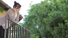 Man climbs up to the balcony for  kiss the woman he loves Stock Footage