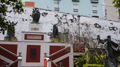 Plaza with statues in colonial old san juan Stock Footage