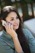 Caucasian woman talking on cell phone Stock Photos