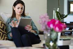 Caucasian woman using tablet computer Stock Photos