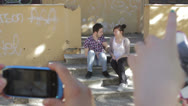 Stock Video Footage of two guys goofing around doing funny poses - cell phones - photo