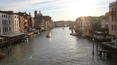 Grand Canal Venice Italy from Bridge with Boats Passing Underneath at Dawn Stock Footage