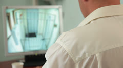 Security guard in control room at CCTV Stock Footage