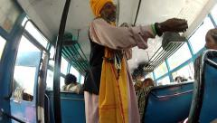 India baba in a bus with a snake Stock Footage