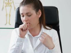 Female doctor coughing in the office, tracking shot NTSC Stock Footage