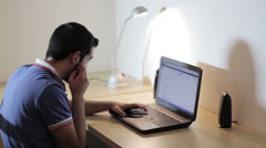 Man working at the laptop  and surfing in internet Stock Footage