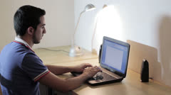 Guy working at the laptop  - write a letter Stock Footage