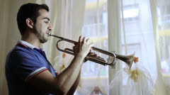 a man playing the trumpet - passion for music - stock footage