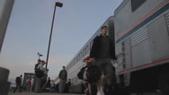 Stock Video Footage of HD Stock Footage - Passengers walk by, low angle, board train, sunset