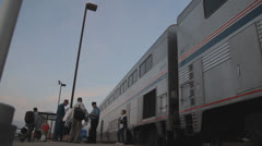 HD Stock Footage - Passengers at train station - Sunset Stock Footage