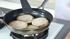 English muffins being toasted in a pan - stock footage