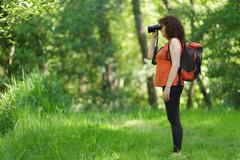 Woman observing wildlife Stock Photos